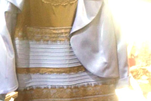 What color dress blue and black or white and gold